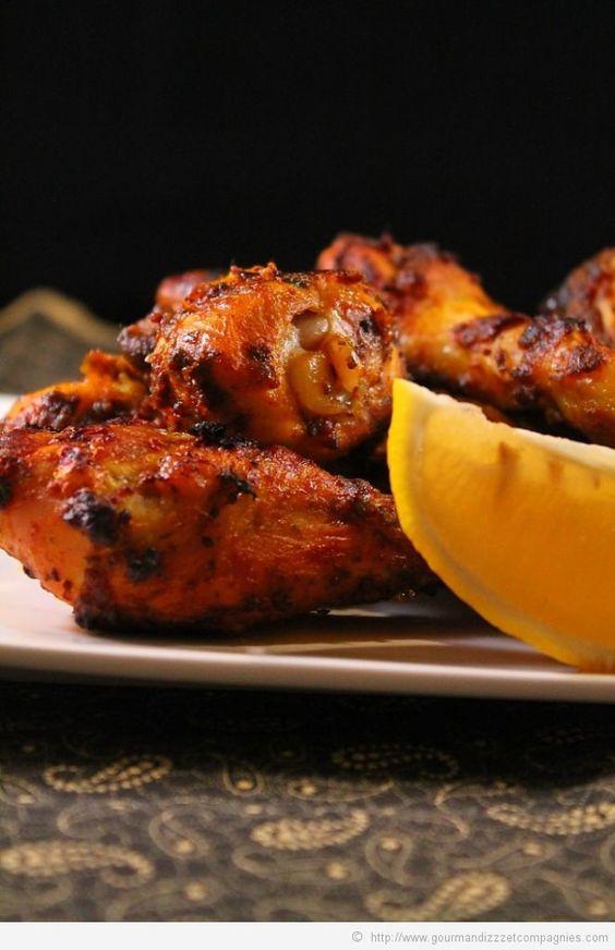 pilons de poulet à la mexicaine  pour 6 pilons 2 citrons 2 cas de ketchup 2 cas de curry 1 cas de persil haché 2cas d huile d arachide sel poivre four a 200°C 30 mn