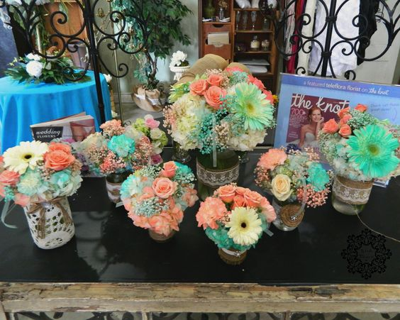 Woods Flowers: Temple, Texas Lovely centerpieces for a bridal shower. Gerbera daisies, carnations, babies breath, and hydrangeas accented with burlap, rustic lace, and jute. Flowers were painted to get the corals and Tiffany blues that the bride wanted.: