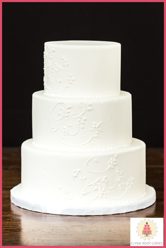 3 tier white wedding cake 3 tier white wedding cake with delicate piped scrolls 10356