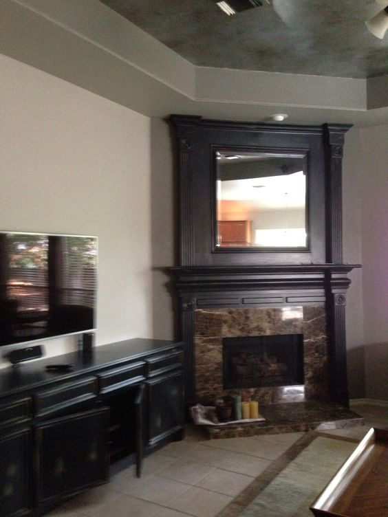 This family room has an elegant distressed entertainment center & fireplace, a beautiful metallic Fauxed ceiling.