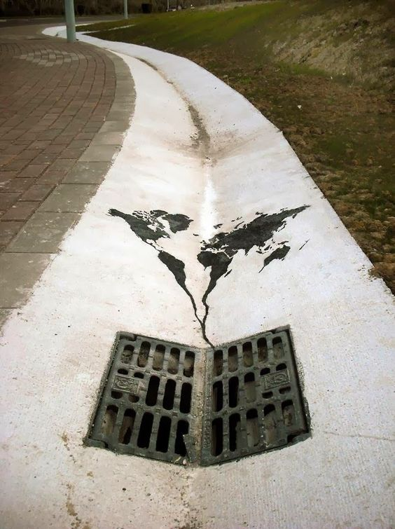 Meaningful Street Art - The world going down the drain: