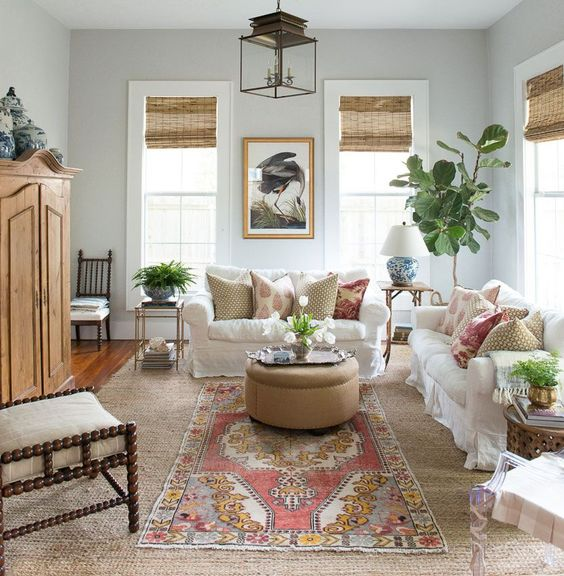 Modern farmhouse decor in a living room in a Texas cottage with interior design by by Holly Mathis. Ikea Ektorp sofas with Bemz Loose Fit Country cover in Absolute white Rosendal Linen. #livingroom #cottage #decorating #modernfarmhouse #ektorp #bemz