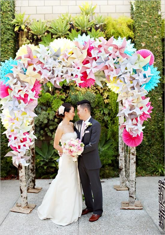 Having the combination of different coloured and textured paper has created a truly sensational wedding arch.