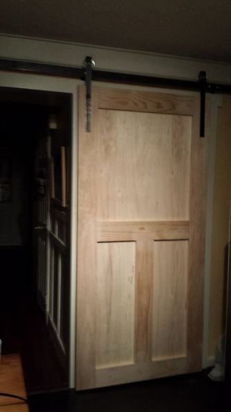 DIY - Barn door sliding hardware for much less than conventional hardware kit.