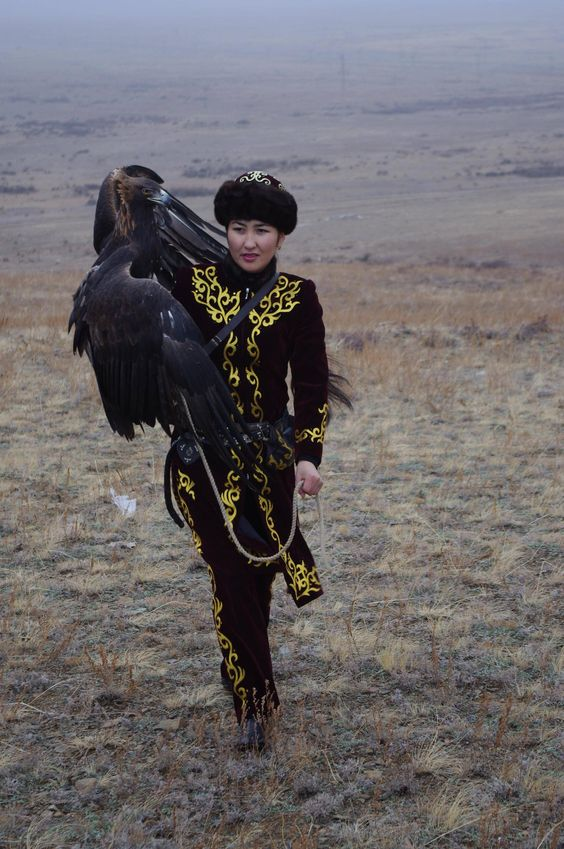 The only Mongolian woman Eagle Hunter with her eagle. 25 year-old Makpal Abdrazakova, the only known female golden eagle hunter, participates in competitions that evaluate how well her eagle, 10-year-old Akzhelke, can catch and kill prey. She has won several of the local contests, which demonstrates the bond between the bird and its master.