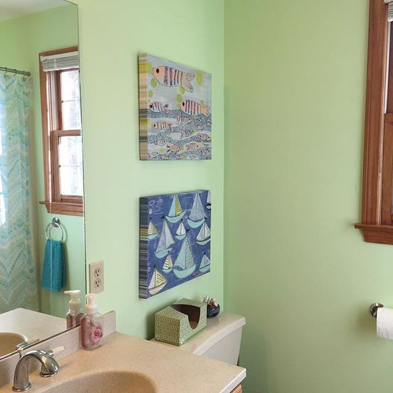 My fishy pattern and blue sailboat pattern canvas reproductions are darling in this bathroom! #seafoamgreen #tealforever #lovecolour #livecolorfully #jengadijean #jengadijeaninspiration #jengadijeanstudio #NewEnglandArtist #childrensart #homedecor #nauticaldecor #whimsy
