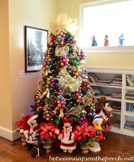 Christmas Tree in Upstairs Hallway with Whimsical Theme balls in clusters of 6 with big ribbon