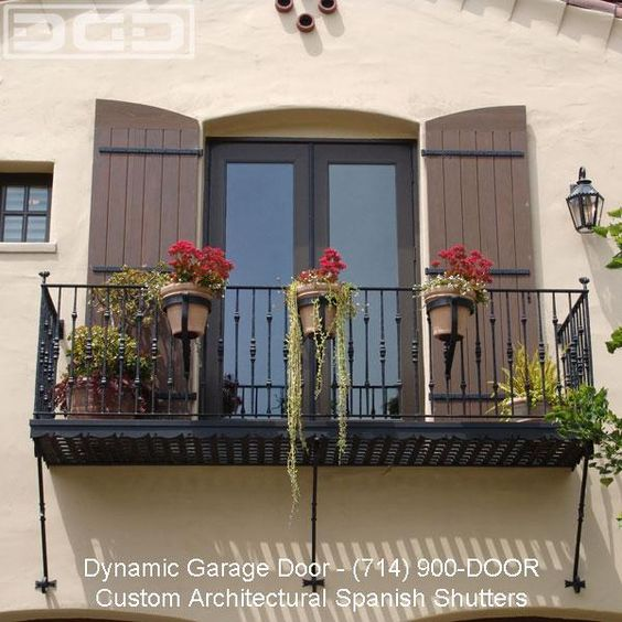 Spanish wood garage doors and shutters on pinterest for Spanish style shutters
