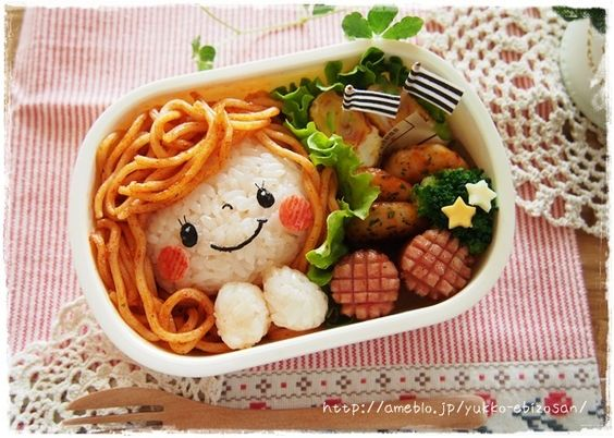 OMG, so cute! I'll have stir fried veggies, a ball of rice (girls face) and noodles (hair) for lunch tomorrow. Finally, an easy to make bento.