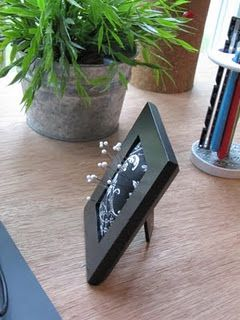 Picture frame pincushion.  Cheap. Easy. Fast. Perfect.