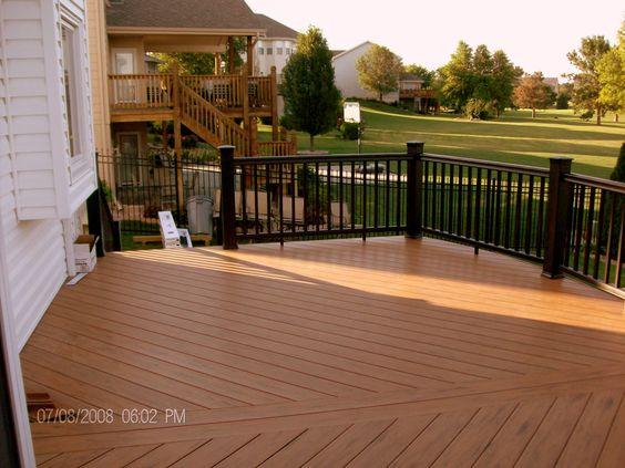 Deck stain dark with black rails mike jansen custom for Staining trex decking