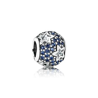 Embrace the beauty of the night sky. PANDORA's innovative use of star-shaped twinkling cubic zirconias, set on a backdrop of sterling silver and midnight blue crystals, creates a stunning hand-finished charm. It is perfect for lovers of stars and sparkles. #PANDORAcharm