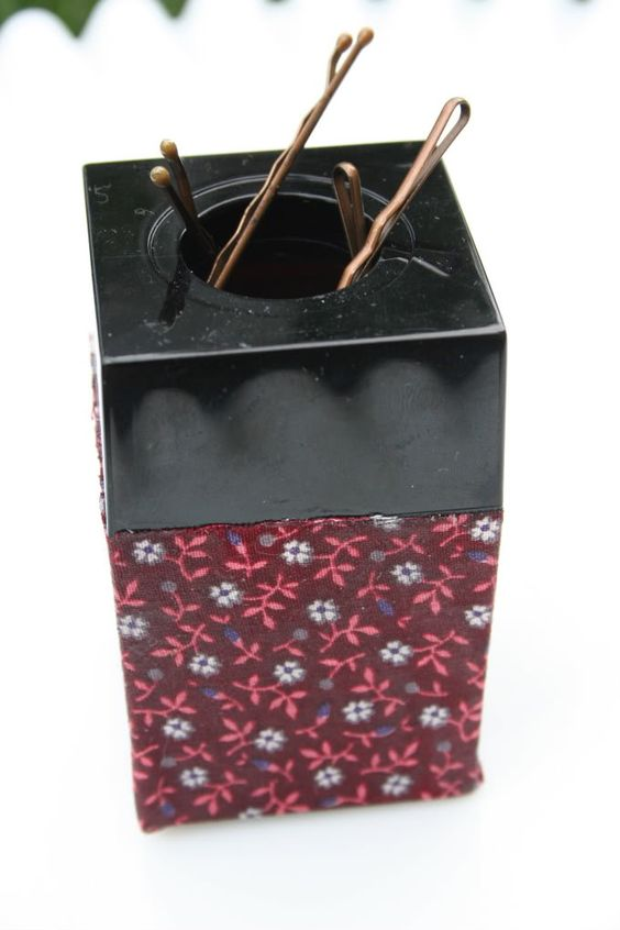 use a paper clip holder to hold your bobby pins.  Genius!