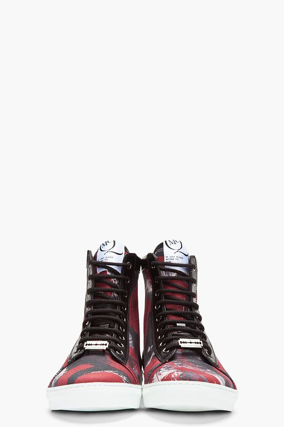 MCQ ALEXANDER MCQUEEN //  Burgundy Paint Print Canvas High-Top Sneakers  32114M050004  High top canvas sneakers in black with paint-effect print in burgundy, grey, and light grey. Round toe. Leather trimmings at eyerow, collar and heel in black. Black lace up closure with silver tone eyelets. Padded collar. Logo patch at tongue. Textured white rubber foxing. Tone on tone stitching. Textile/leather upper, rubber sole.  $480 CAD