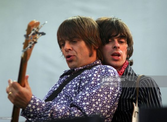 Gary 'Mani' Mounfield and Barrie Cadogan of Primal Scream perform on stage on the second day of the annual Nokia Isle Of Wight Festival at Seaclose Park on June 10, 2006 in Newport, England.