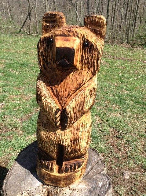 Chainsaw carved bear little on tree