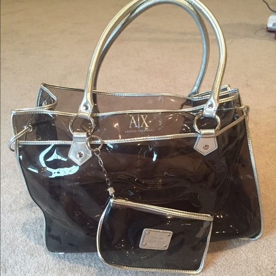 Armani Exchange tote bag with wristlet Armani Exchange tote bag, comes with wristlet. Bag can be used for the beach. Excellent condition. Armani Exchange Bags Totes