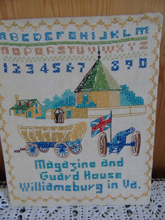 Vintage, completed cross stitch sampler of the Magazine and Guard House, Williamsburg, Virginia.  In fine condition.