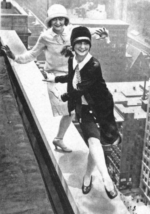 Flappers dancing the Charleston on the edge, New York City, ca. 1920s