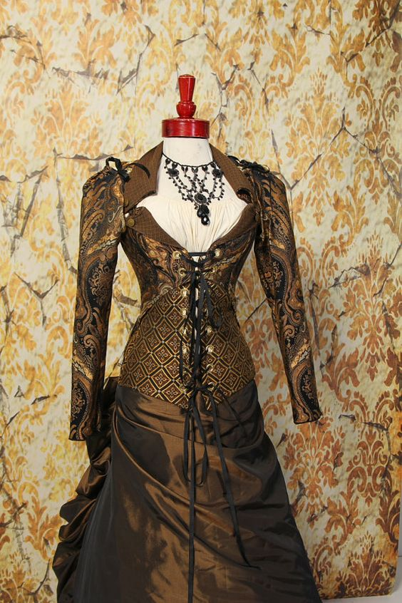 NEWBust 33 to 36 Black and Gold Paisley by damselinthisdress, $239.00 I love everything about this coat (and corset). The skirt would be more pirate, less steam.