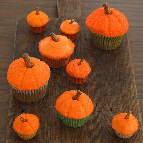 Pumpkin cupcakes with a pretzel as the stalk.