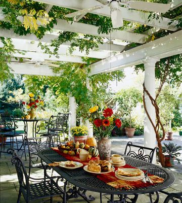 Outdoor Living  When attached to the house, a dining pergola like this can more easily be fitted with amenities such as wiring for a ceiling fan. This patio is large enough to accommodate more than one dining group as well.  I'm all about outdoor living!!