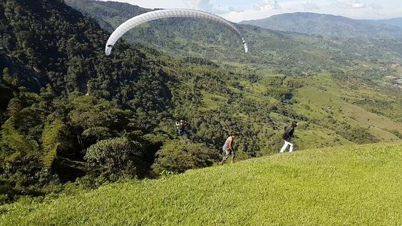 Paragliding over giant waterfalls - Image 13