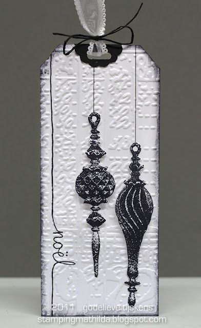 pretty bauble ornaments on white embossed bkgrd: