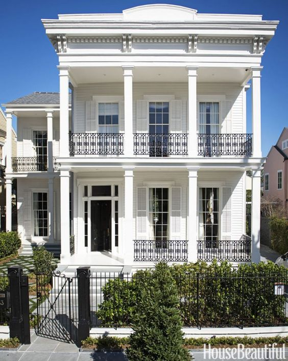 house beautiful-new-orleans-greek-revival-photo - Paul Costello | Love that they used one paint color for everything including the shutters. What an architectural gem!