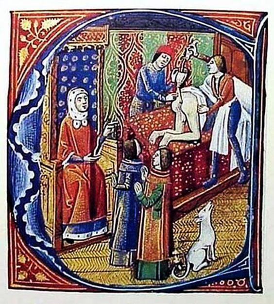 Medieval depiction of an enema being performed