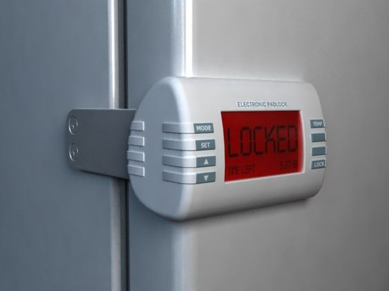 The Lock Blocking The Doors Of The Refrigerator In A