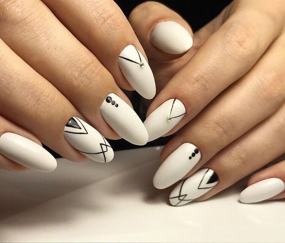 White matte manicure looks great with any your image. The oval shape on the long nails looks very feminine. Varnish ...