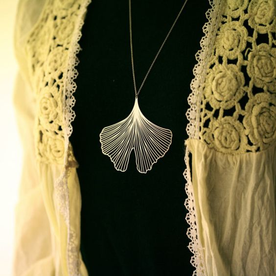 I know I don't normally pin jewelry, but this is inspired! A gold gingko pendant $32