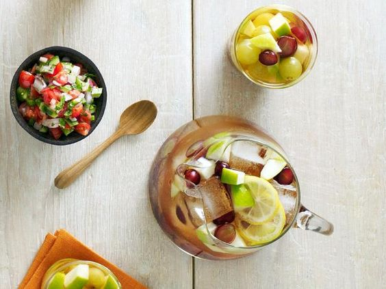 Apples, lemon and grapes make up the fruity base of this Party-Ready Sangria. For a chilly surprise, the Neelys add frozen green grapes to help keep the drink cold.  #RecipeOfTheDay: