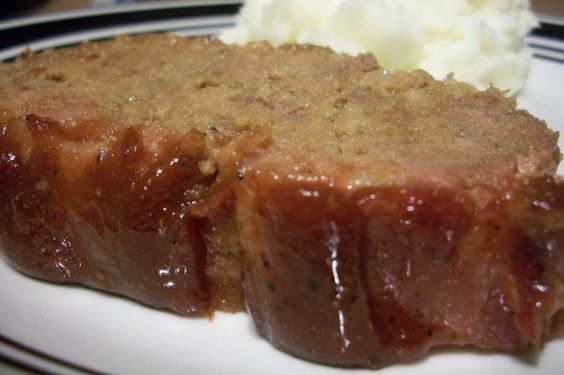 """Amish Meatloaf Recipe from Food.com: After traveling in eastern Ohio and eating many different """"Amish-style"""" meatloaves, I finally asked for this wonderful meatloaf recipe. This one is not as sweet as the typical Amish recipe and has some garlic flavoring in it. We love it!!"""