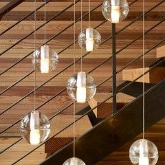 lights in modern staircase by John Maniscalco Architecture