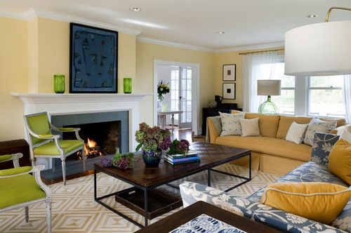 A sweet pair of wide mat gallery frames makes a corner more special.   HOUZZ - traditional living room by Andrew Suvalsky Designs