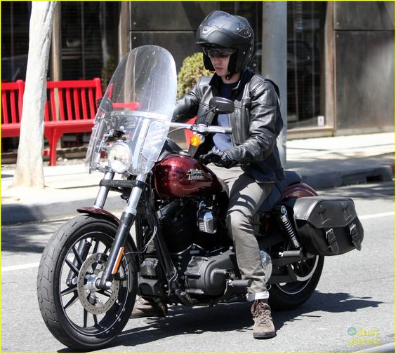 Nicholas Hoult shows off his new Harley Davidson motorbike as he stops off for gas on Friday afternoon (April 12) in Los Angeles.
