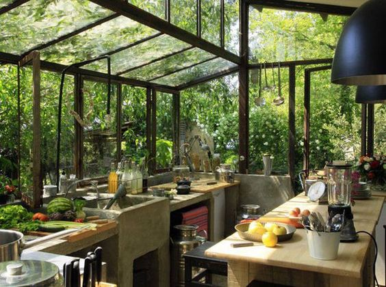 Nice and peaceful kitchen. Conveniently by a garden so someone could grab fresh produce as they cooked.