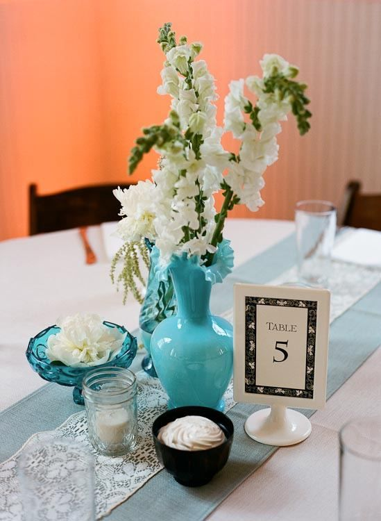 cute centerpieces... minus the flower + twigs. Could even spray pain twigs black...