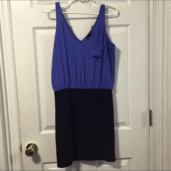 Aqua Bodycon Dress Perfect dress for going out! The bottom is tight/bodycon and top is more relaxed fit. Cute pocket detail. Great condition, worn once & dry cleaned. Purchased at Bloomingdales. Aqua Dresses