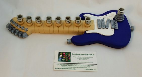 Fender Electric Guitar Menorah - now with raised cups higher off the clay. Made by Michelle Mathis Burckhalter using polymer clay - NO PAINTS!  Order info: michellemathis@claycreationsbymichelle.com