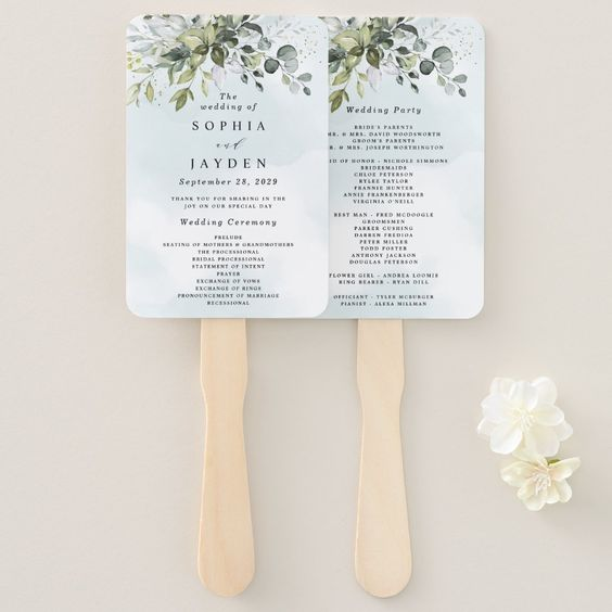 fan made out of a wedding program for a summer wedding