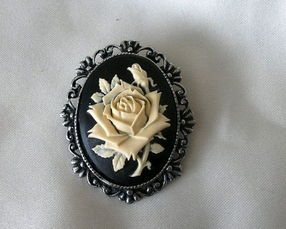 Rose cameo pin brooch    Beautiful highly detailed pin brooch.  Ornate antique pewter setting , featuring an ivory rose on jet black