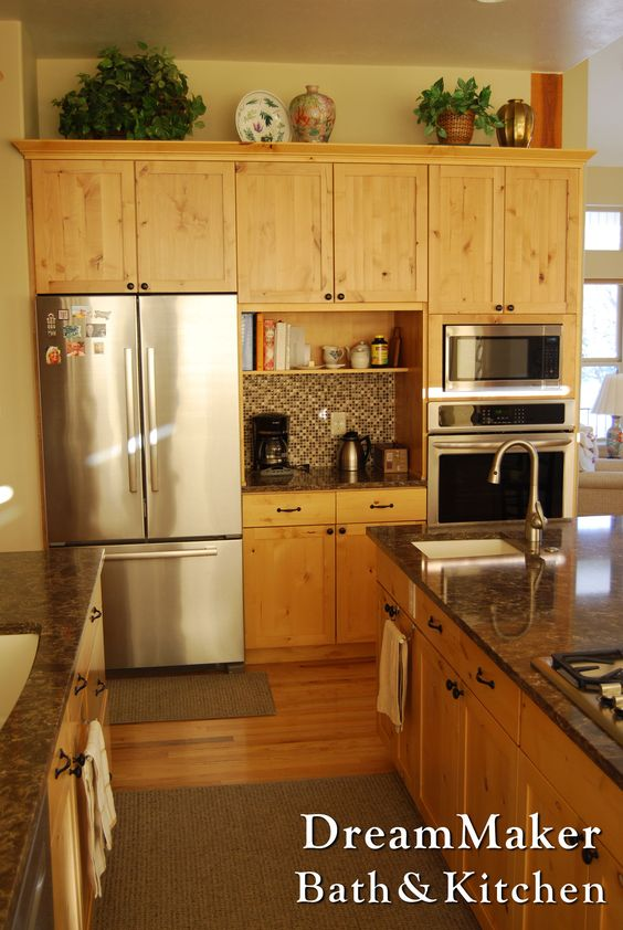 Natural knotty alder cabinetry paired with quartz countertops.