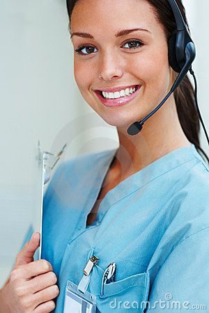Stock Photography Beautiful medical Receptionist wearing headset - medical receptionist