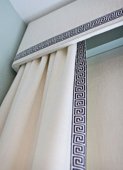 You can never go wrong with a greek key trim on solid fabric... it always works.