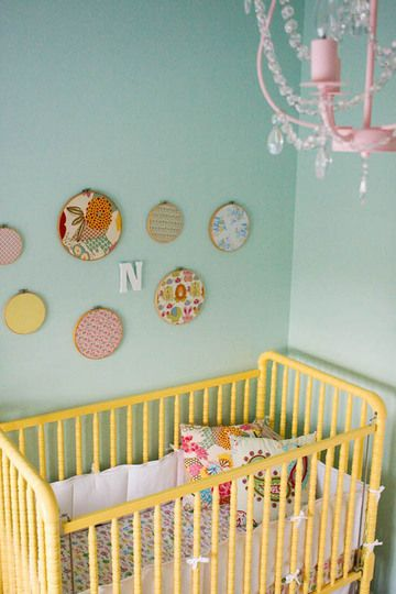 Embroidery hoops as wall decor: Love this easy decoration idea! Such a simple way to add pretty fabric to a room.
