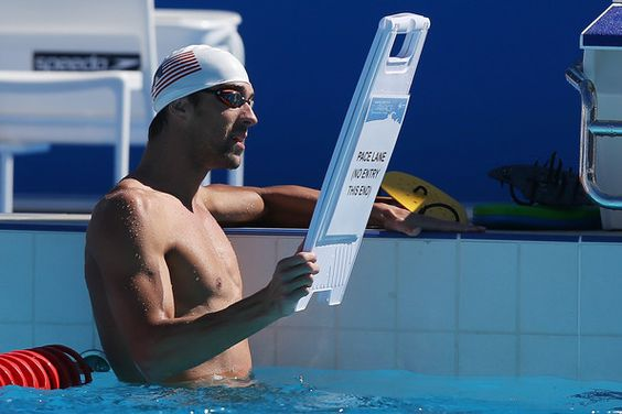 Michael Phelps Photos Photos - Michael Phelps tells another swimmer to change lanes during a Team USA Pan Pacs training session at the Gold Coast Aquatic Centre on August 19, 2014 in Gold Coast, Australia. - Team USA Pan Pacs Squad Training Session