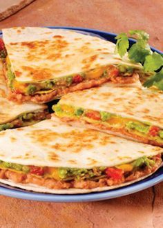 ... refried beans, spicy tomatoes, cheese and avocado layered in tortilla